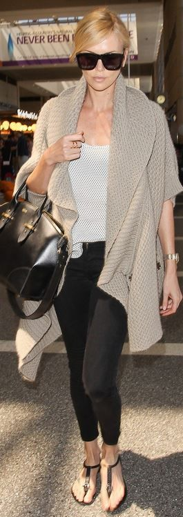 Charlize Theron: Sunglasses – Karen Walker  Purse – Alexander McQueen
