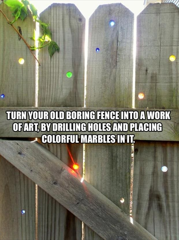 convert an old wooden fence into a glimmering work of art by drilling holes in the wood and inserting colorful glass marbles