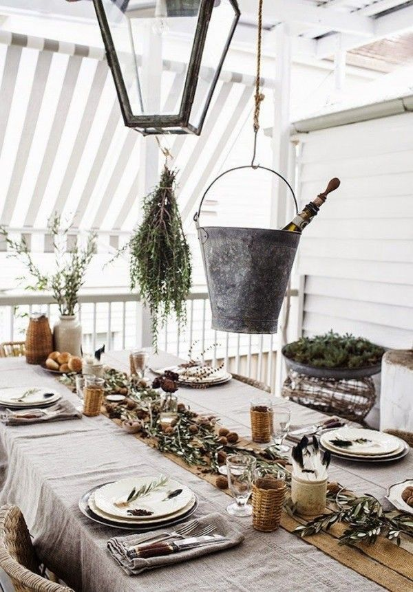 Winter tablescape decorating ideas for after Christmas. Don't pack away all of your Christmas decorations! Create winter tablescapes and winter centerpieces using natural decor.