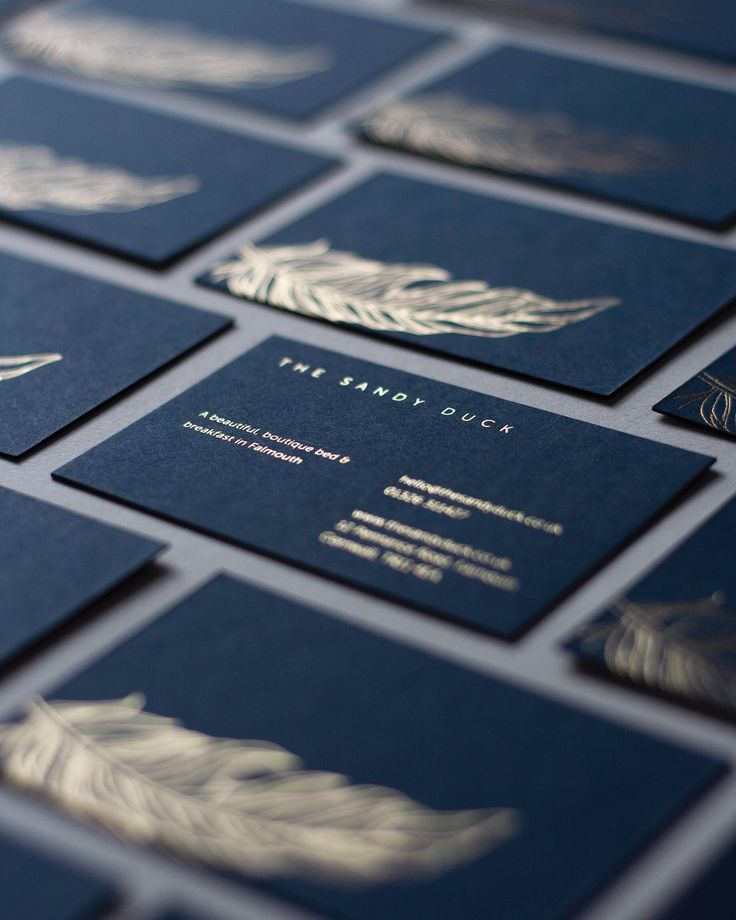 Gold foil blocking on 540gsm Imperial blue Colorplan paper. Business cards printed for The Sandy Duck