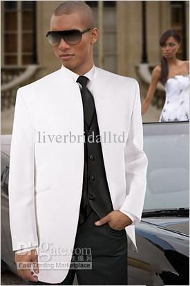 White Tuxedo Wedding Groom