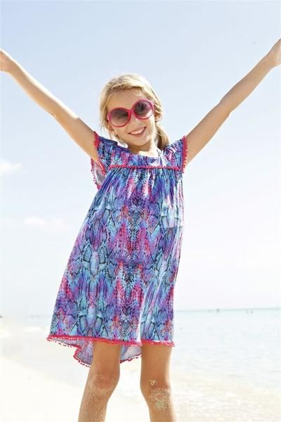 Whether it's a birthday party, a beach trip or just another day at school she'll be cheering for a exotically printed dress that feels celebratory.  #designerkids #coverup #beachdress