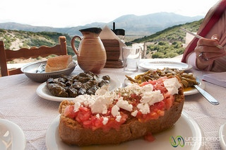 Crete Food with a View - Lassithi, Crete Dakos (dried bread dipped in water and covered with crushed tomatoes, olive oil and feta cheese), dolmades (stuffed vine leaves) and fasolakia (fresh beans with tomatoes and olive oil) for lunch. We have tried them all!