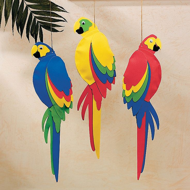 Sympa à faire ces perroquets en papier colorés. Inspiration.  Colorful Jumbo Parrots. Hang several of these foam parrots together for a colorful island display!