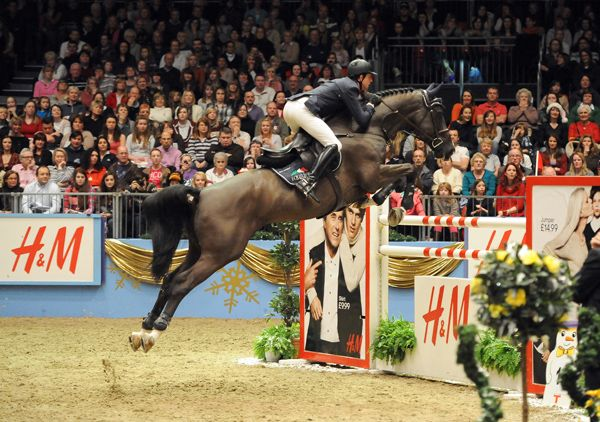 Ben Maher and Tripple X III. Have to say the horse has amazing form...rider, not so much!