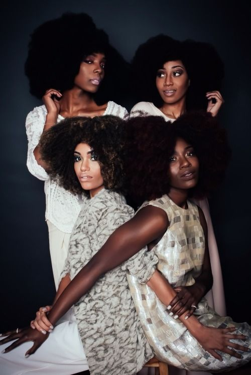 4 women with curly hair