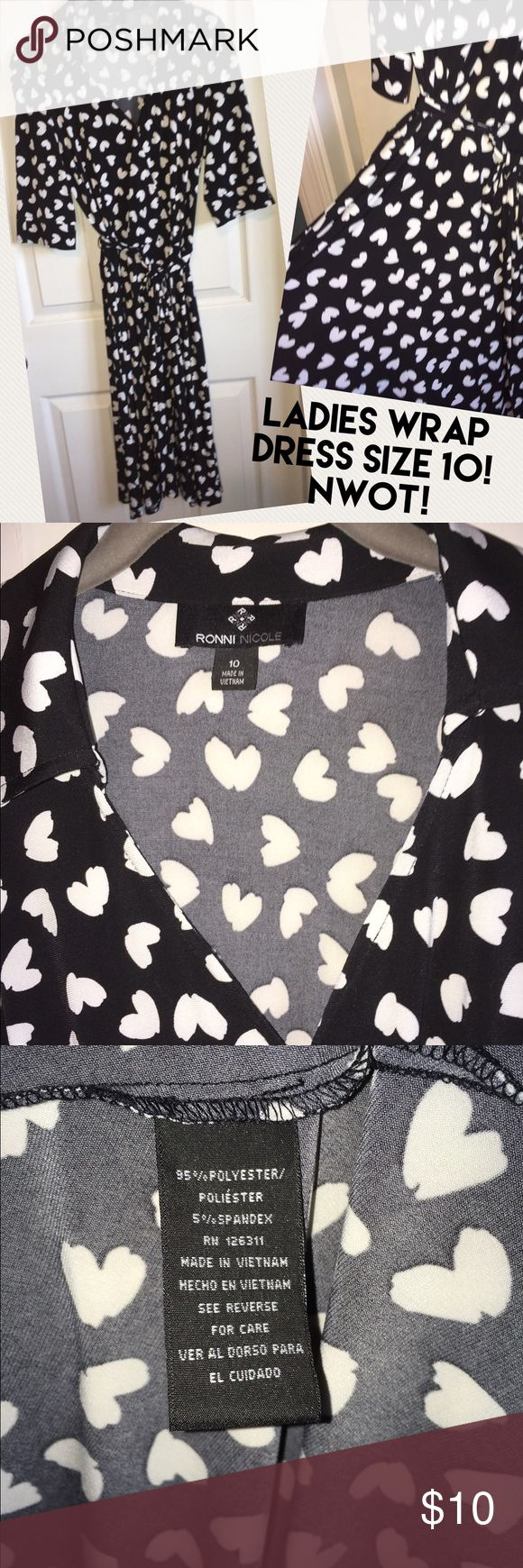 Super cute HEARTS Ladies wrap dress sz 10! This black & white wrap dress is so CUTE! I bought it to wear to a work event and ended up wearing pants instead, so it's NWOT. The brand is Ronni Nicole, I bought it at our Marine Corps exchange. See pics of tags for care instructions :) Ronni Nicole Dresses Midi