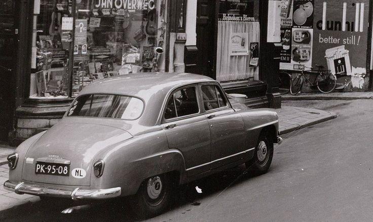 1960's. 1954 Simca Aronde (PK-95-08) parked at the Nieuwendijk in Amsterdam. Photo Collectie Archief van het Bureau Monumentenzorg. #amsterdam #1960