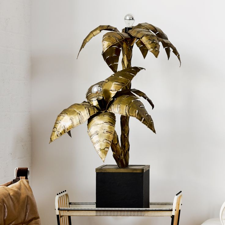 The Maison Jansen Palm Lamp, designed in the 1970's, was produced in many iterations and it's blingy brass with dramatic and opulent form oozes 1970's hollywood glamour. A highly collectable piece. Rewired to Australian standards.