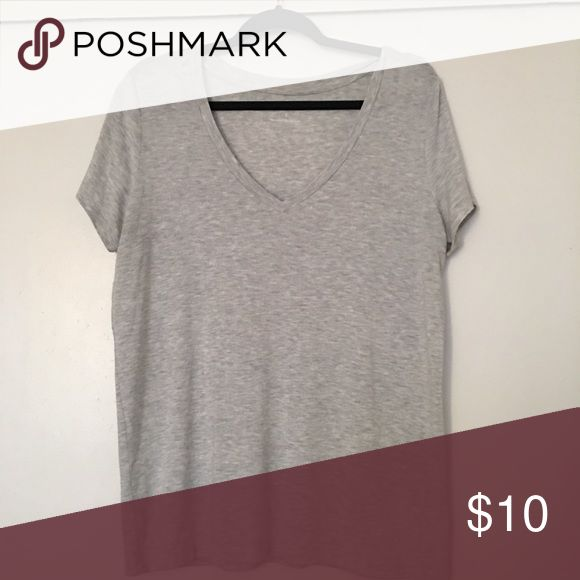 Express One Eleven skimming tee This shirt has 5 star reviews on Express. This shift is in excellent condition as I've only worn once! This shirt is super soft and comfortable ! The color is heather gray .Sold out in Express. Price firm Express Tops Tees - Short Sleeve