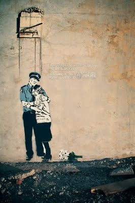NZ Police street art advertising by artist Otis Frizzell. This one in Christchurch shows a police officer comforting families in the aftermath of the Christchurch Earthquake.