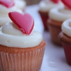 Mini Raspberry Champagne Cupcakes, Cream Cheese frosting, topped with the perfect red chocolate heart for Valentine's Day!