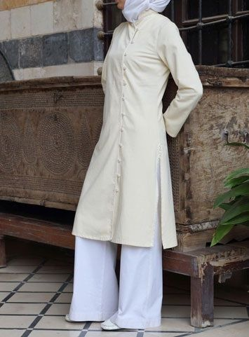 Pleiku Tunic Save 44% Buttercream color  An exquisite tunic featuring twine embroidery. Fantastic for occasions where you want to look stunning, but remain modest.