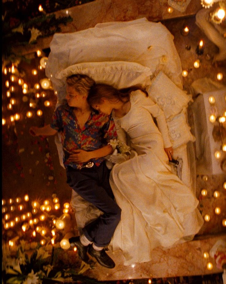 Romeo + Juliet (1996). Love the pic~ lived the story. Alive but dead. (I couldn't live like that).