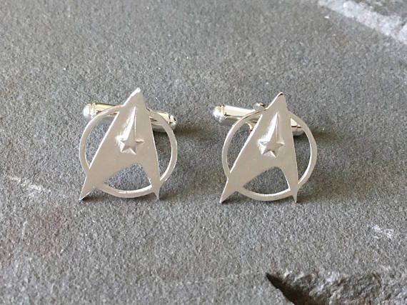 These Star Trek cufflinks are made from sterling silver, they are great for the Trekkie in your life! I designed these in 3D software and then got them 3D printed in castable wax and then cast in sterling silver using the lost-wax casting process. They are approximately 1.7cm x 2.2cm