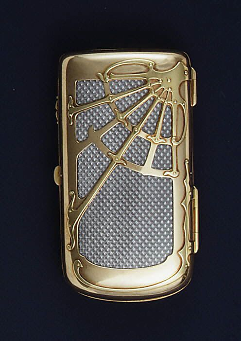 From the House of Carl Faberge Comes This Intriguing  Cigarette Case a Piece of Art by Metal-Master Worker Mikhail Evlampievich Perkhin, (Russian, 1860–1903) of Silver Gold and Enamel, St. Petersburg, Russia, ca. 1900.