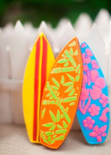 Colorful Surfboard Custom Sugar Cookies Resting on the Fence
