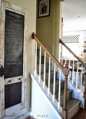 {message board} Old door turned message board with hooks for backpacks! Down to Earth Style: House Tour 2