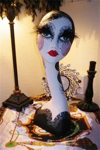 tall art deco mannequin with feather eyelashes by evie sweetie
