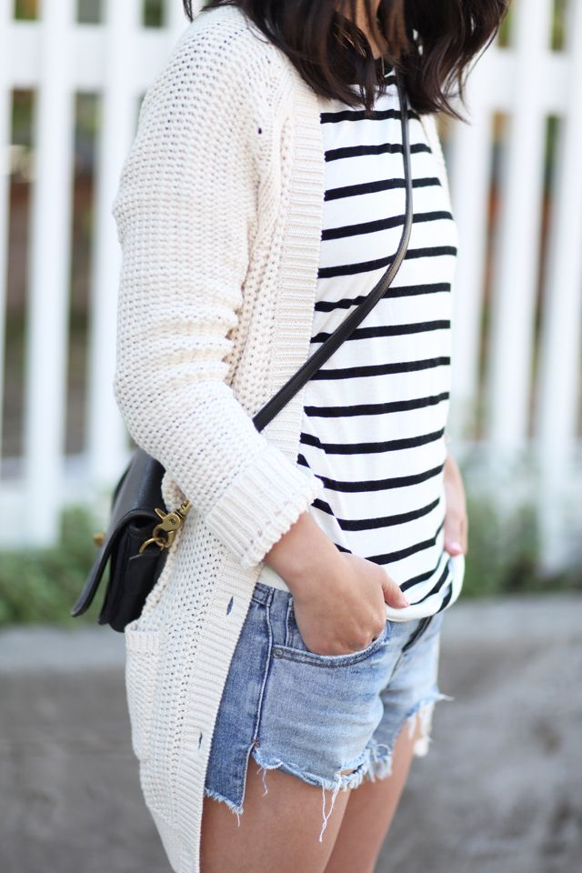 Gap cable knit cardigan with striped black and white shirt, cut offs and black flats, vans or converse.