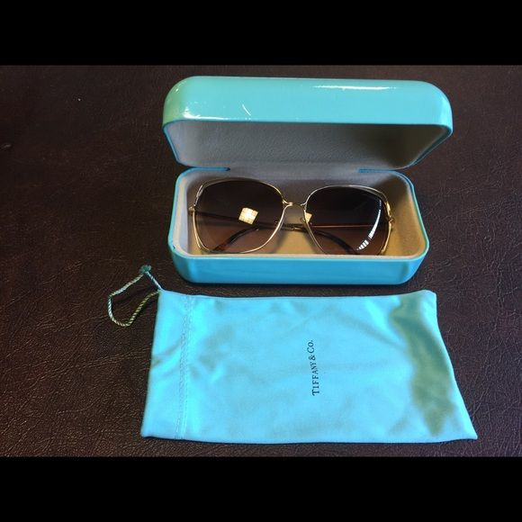 Tiffany sunglasses Mint condition like new gold Tiffany sunglasses with the original case and dust cloth. Tiffany & Co. Accessories Sunglasses