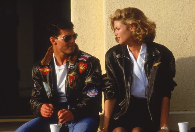Still of Tom Cruise and Kelly McGillis in Top Gun.  Never noticed the Texas flag on his jacket.