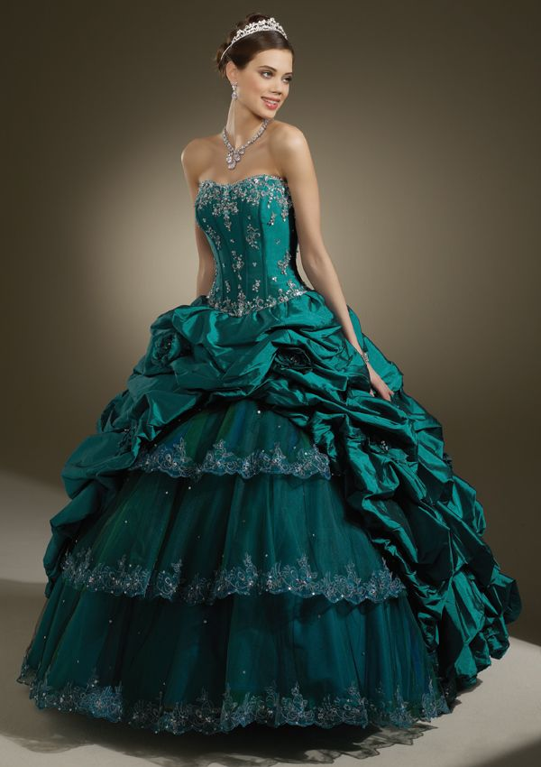 Long strapless emerald green dress with silver rhinestone accents & tiered skirt from Vizcaya By Mori Lee (Style: 87084).