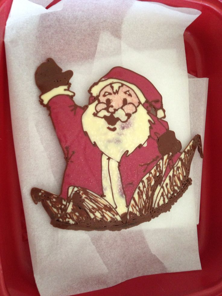 Chocolate Santa for a cake topping... Win.  Full cake image to come.