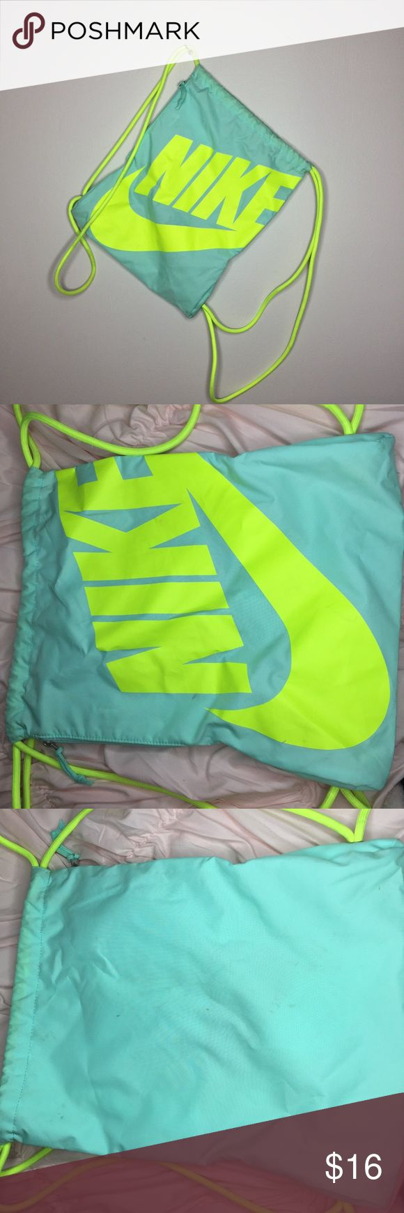 Nike Neon Sling Bag. In good pre-loved condition. Has some markings on the back of the bag.OFFERS WELCOME Nike Bags Backpacks