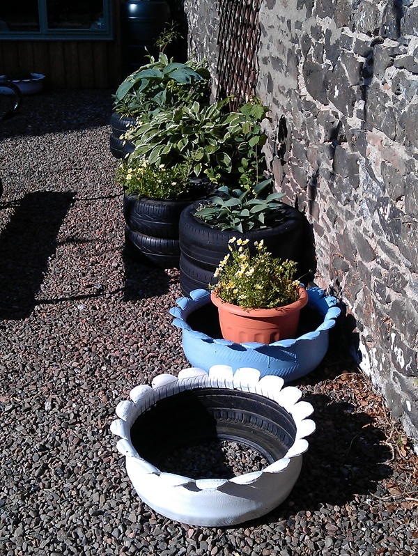 Zone a the rubber room plant pots made from old car for Car tire flower planter