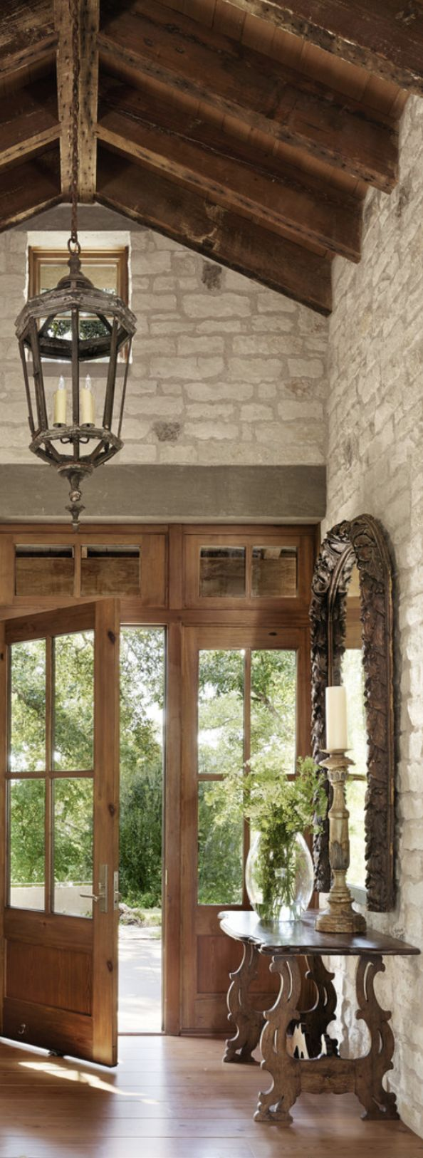 rustic elegance. foyer with vault, wood beams, French doors, elegant lighting and mirrors. home accents Nashville.com