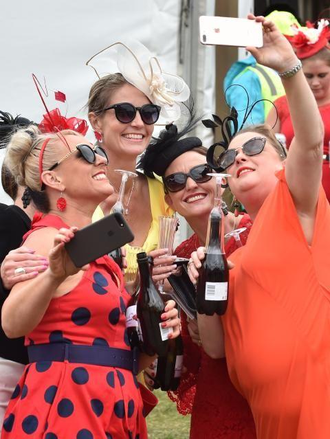 Women pose for a selfie at Flemington. Picture: AFP