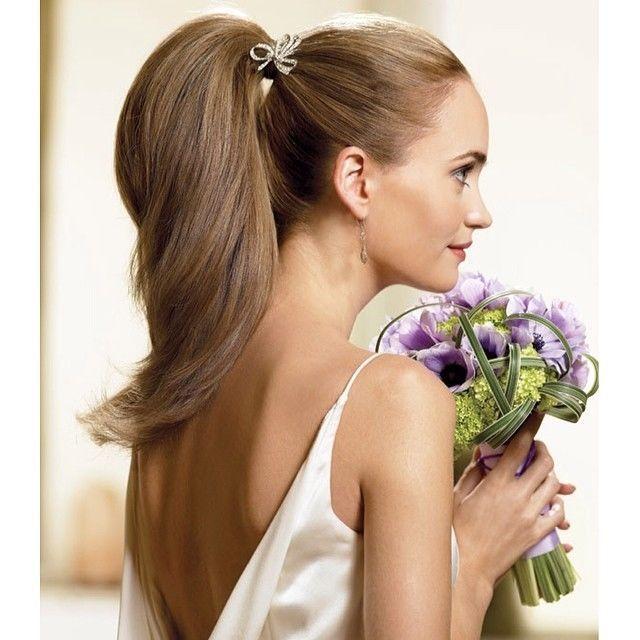 Свадебные варианты причёсок на длинные волосы. Фото №11