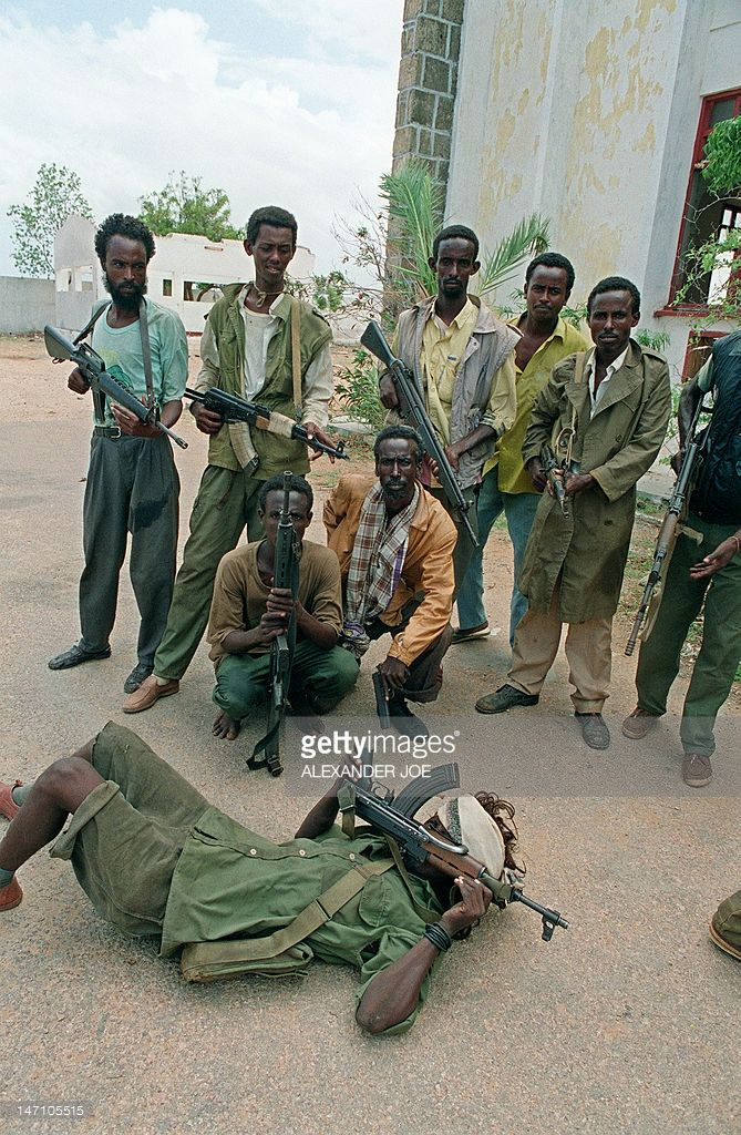 Clan fighters loyal to the joint force of the United Somali Congress (USC) of warlords General Mohamed Farah Aidid and the Somali Patriotic Movement (SPM) of Colonel Omar Jess, pose 15 May 1992 in front of a building after they captured Somalia's southern port of Kismayu from General Morgan, the son-in-law of deposed Somali President Mohamed Siad Barre. In the decade since civil war prompted the fall of Somali president Siad Barre in January 1991, the country has been ravaged not only by…
