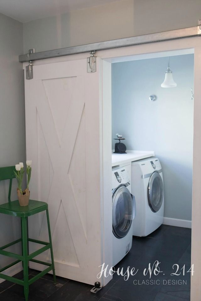 DIY Rolling Barn Door in the laundry room eclecticallyvintage.com