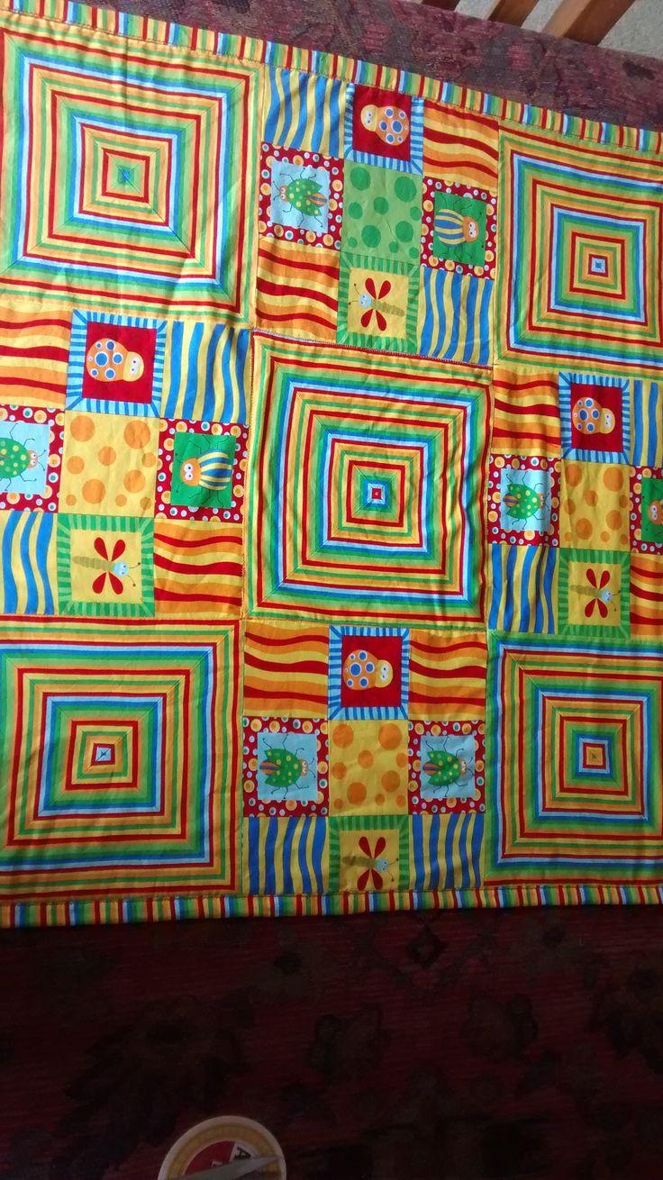 """simple"" mitred patchwork baby mat. polar fleece backing"