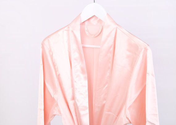 This beautiful plain wedding robe, perfect whilst you are getting ready on the morning of your wedding or for lounging round the pool on your spa hen weekend.   The stunning gowns are designed with Kimono Lace sleeves  We are the UKs largest supplier of wedding robes. THE home for Bridal Robes/Gowns. We have many options and colours for your Bridesmaids, Maid of Honour, Mother of the Bride, and Mother of the Groom (and the Bride, of course)!!!  Exclusive personalised designed robes, we have…