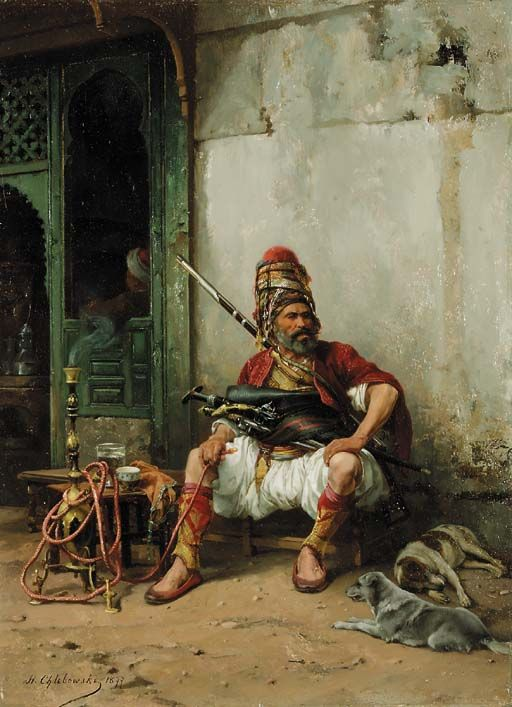 "Bashi-Bazook with hookah, 1877, Stanislaw Chlebowski (1835–1884) was a Polish painter with Russian and Turkish connections. He was a renowned specialist in oriental themes. Bashi-bazouk or bashibazouk (Turkish literally ""damaged head"", meaning ""free headed"", ""leaderless"", ""disorderly"") was an irregular soldier of the Ottoman army. Particularly noted for their lack of discipline."