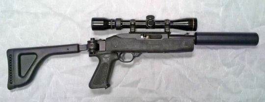 Ruger 10/22 SBR with 11 inch barrel fitted with a Choate folding stock and permanently attached Sound Tech Suppresso