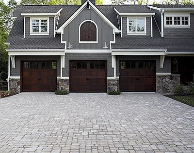 I like driveway stone. Space them out more and add some grass. I also like the stone on the house and the garage doors and paint colors