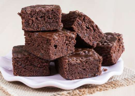 """Slide 4 of 14: <p> Mixing a can of Diet Coke into a box of fudge brownie mix will make <a href=""""http://auntpegsrecipebox.blogspot.com/2011/02/diet-coke-brownies.html"""">perfectly cooked, extra moist brownies</a>.</p>"""