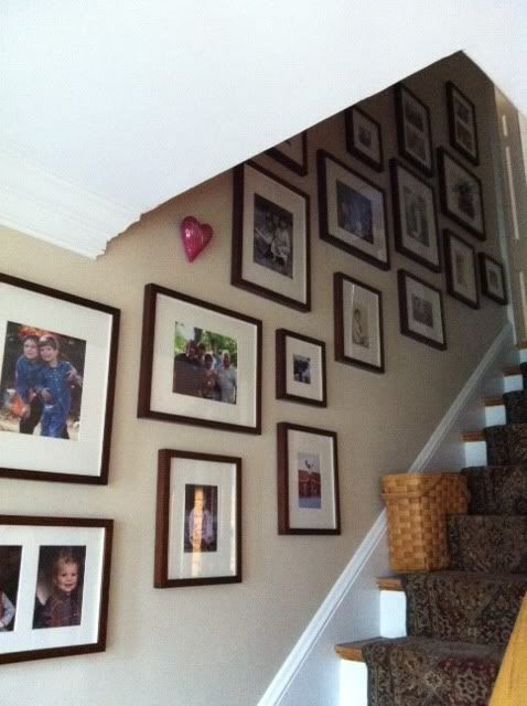 Stairway wall gallery - tip, use command picture hanging strips so pictures don't get jostled all the time.  Also, before hanging the actual pictures, cut out brown packing paper that is the same size as each frame and hang that so you can see the spacing.