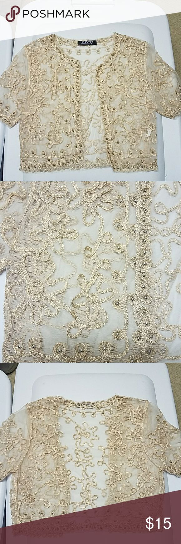 Open beaded gold cardigan.  Size Small Great for a special occasion.  Wear over a dress. It's a size small,  even though there is no label showing the size.  Wore once.  In excellent condition.  No beads have fallen off. Sweaters Cardigans