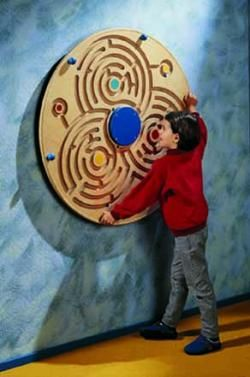 Labyrinth Wall Game Beautiful design and great training for hand-eye coordination. Mounts directly to the wall; no loose pieces; plexi-glass cover. Ball-bearing ensures smooth spinning.