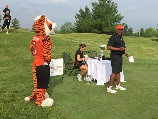 Marvin Lewis' charity outing a hit. Photo: Bengals head coach Marvin Lewis has a laugh while introducing his golf outing celebrities. The Enquirer/Jim Owczarski