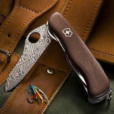 From Victorinox, Makers of the Original Swiss Army Knife, an Heirloom Quality Limited Edition Collector's Knife in Walnut and Rare Damascus Steel!