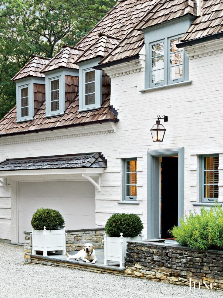 Traditional White Brick Exterior with Boxwoods
