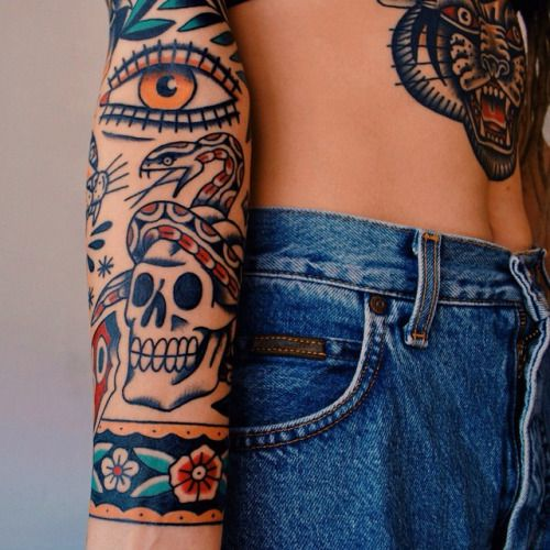 old school tattoo sleeve and chest tattoo