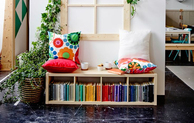 A picture of a window seat made from shelving with pillows on top.entertainment while you're sitting there. KALLAXShelving unit $59.99