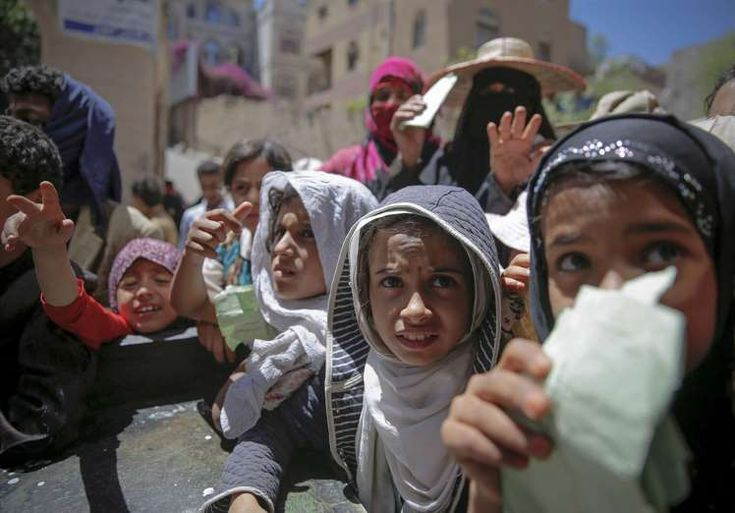 YEMEN: More Than a Thousand Days of War in Yemen - December 30, 2017.  Yemenis receive food rations provided by a local charity in Sanaa on April 13, 2017.